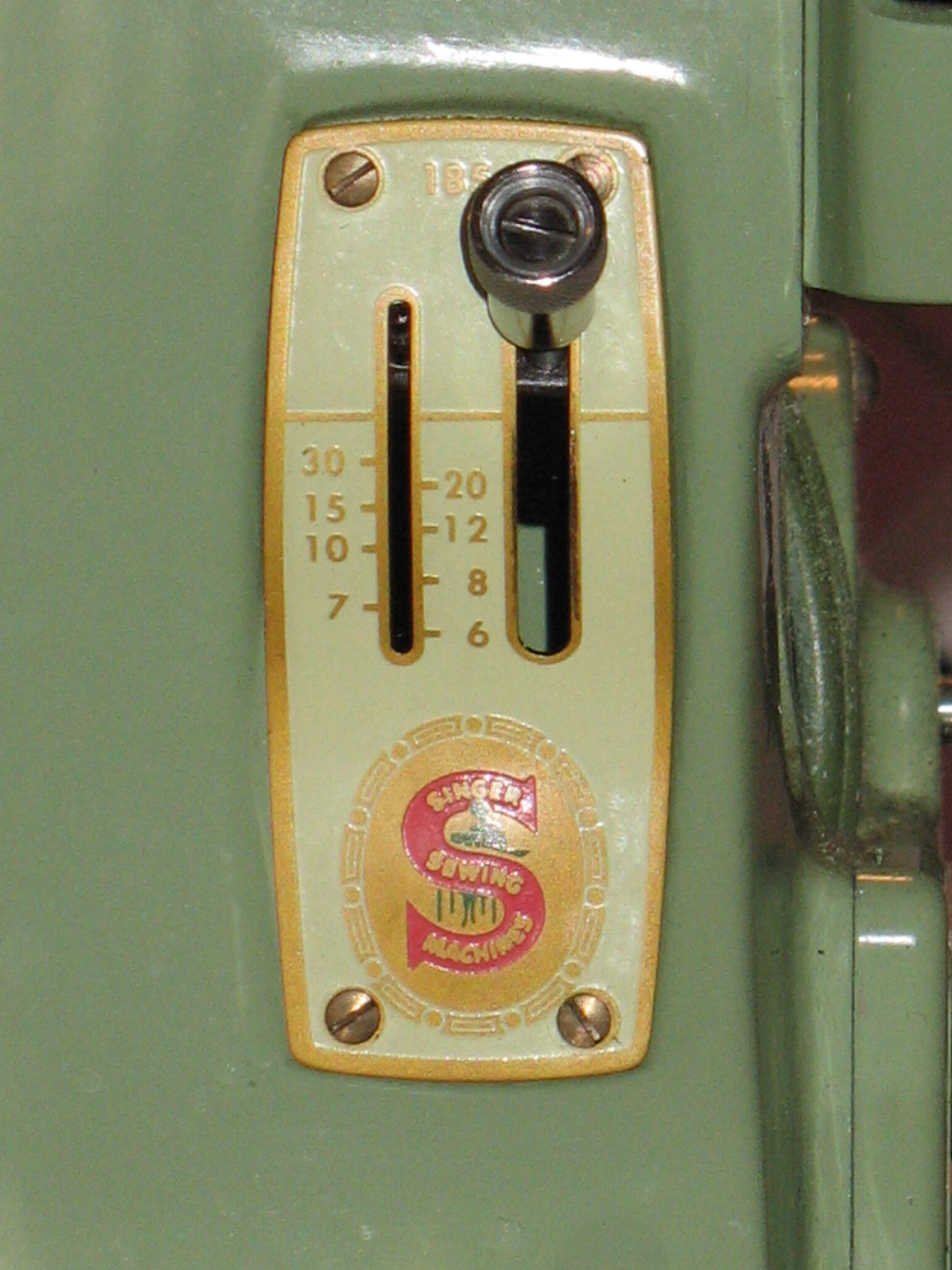 sewing machine with stitch regulator