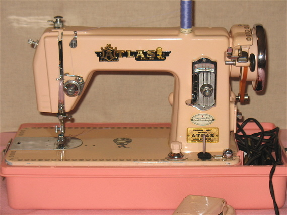 Vintage pink atlas sewing machine attachment feet set and manual.
